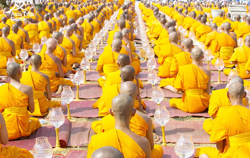 Buddhist monks pray to Buddha and candles in Chiang Rai