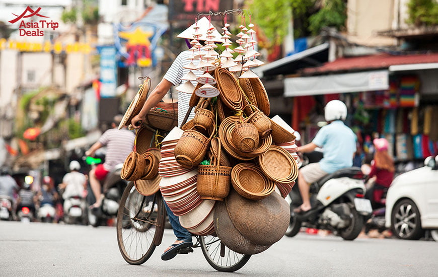street vendor selling bamboo crafts on street of Hanoi