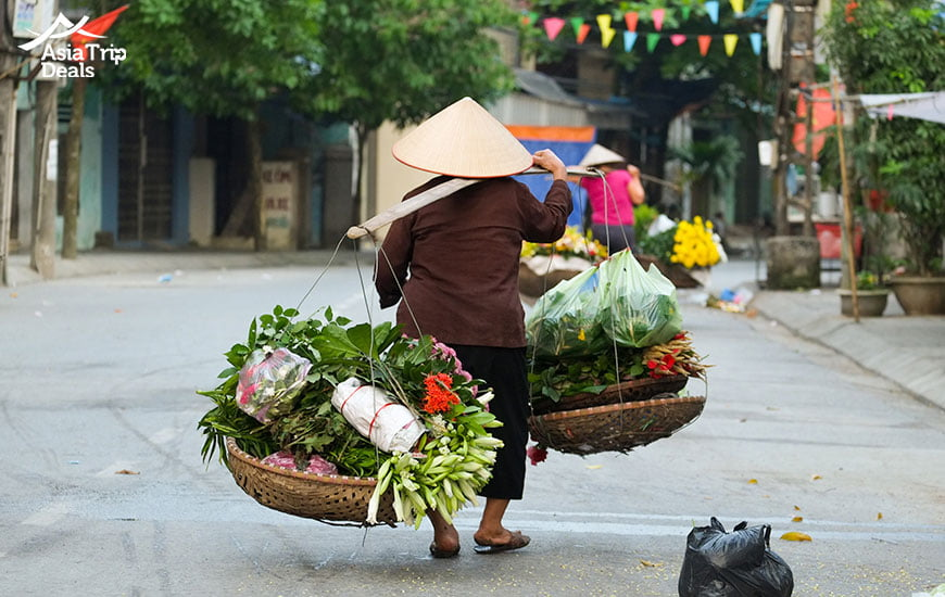A florist vendor in Hanoi in the early morning