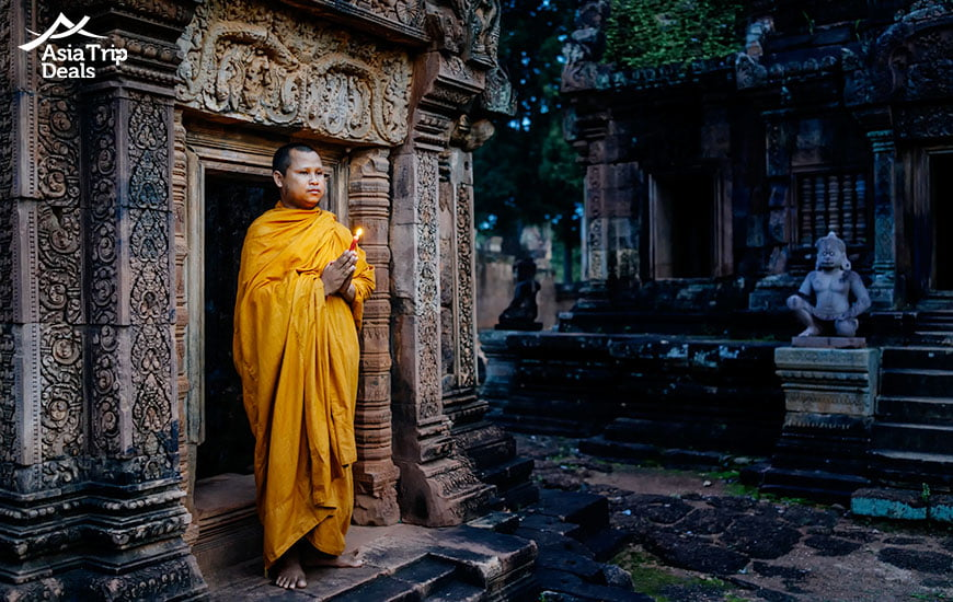 A monk posing in a temple in Cambodia