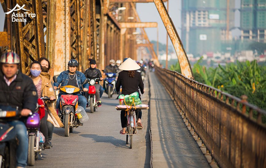 People riding motorbike on Long Bien bridge in Hanoi