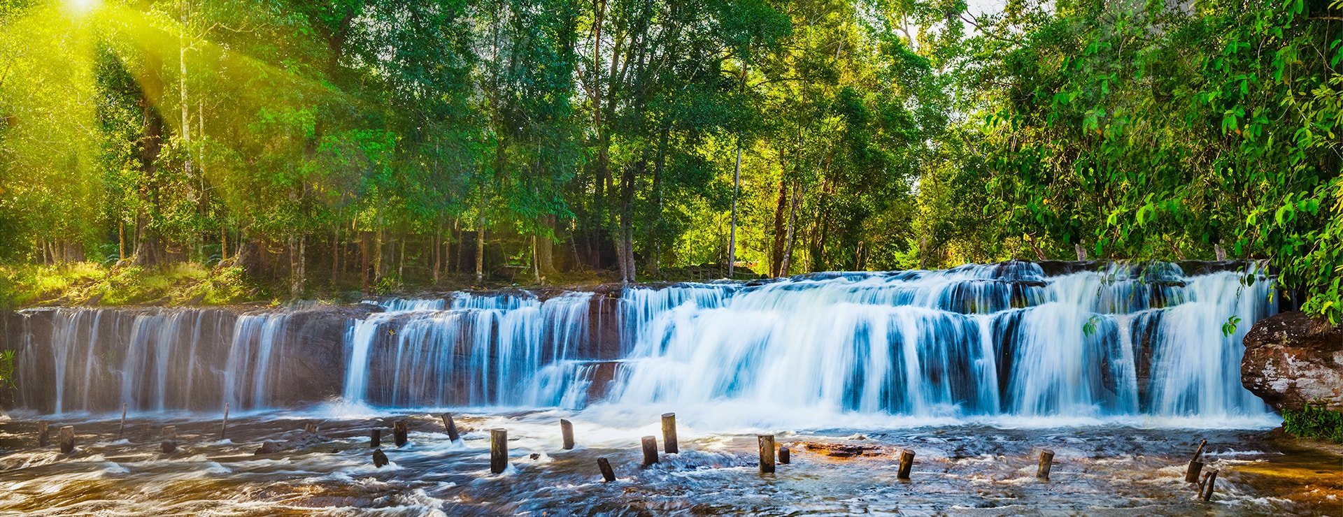 Tropical waterfall Phnom Kulen during sunrise, Cambodia