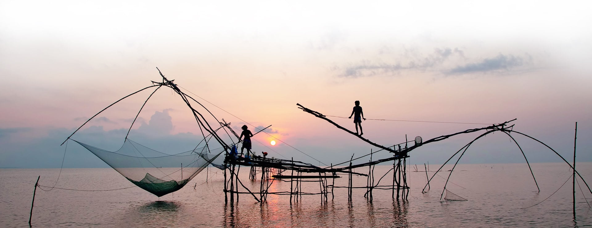 Fishermen at sunset in Danang