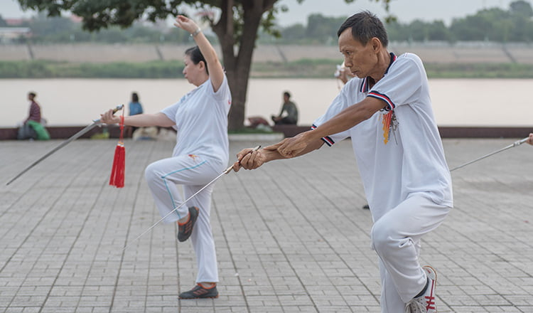 Local people do taichi in the morning