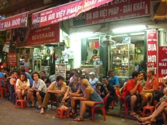 enjoy fresh beer on a plastic stool in vietnam